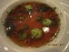 Равиолли с козьим сыром в бульоне из раковых шеек с зелеными бобами и лимонным сорго